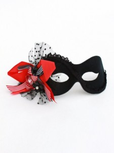 Black Masquerade Mask with red, white and black bow, net, and jewels
