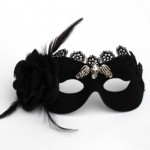 Black Gothic masquerade mask with black rose and feathers and lace and silver skull