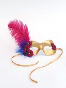 Gold mask with hot pink and blue flowers and hot pink ostrich feather