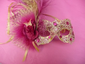 Hot pink and gold bollywood style masquerade mask with large gold and pink ostrich feathers