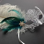 66. silver burano lace mask with teal feathers