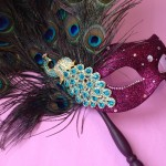 63. burgundy peacock feather masquerade mask