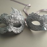86. Couple's ornate silver lace venetian masks