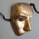 81. hand decorated gold phantom mask