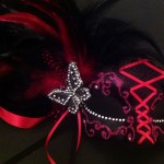 43. pink & black feather lace up mask