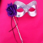 silver stick mask with purple flower