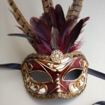 76. burgundy venetian musica mask with feathers
