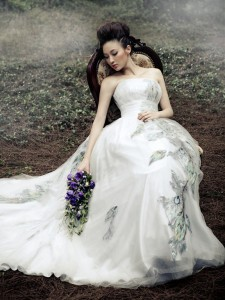 white peacock wedding dress