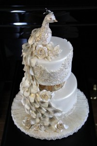 white pearl masquerade peacock wedding cake